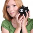 Foto de Stock  : Young woman with money box