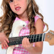 Little girl playing electric guitar — Stock Photo #14100313