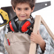 Young boy with adult carpenter — Stock Photo #14100339
