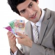 Businessman holding Euro bank notes — Stock Photo #14100463