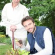 Stock Photo: Young mgardening with older woman