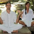 Couple meditating in stone garden — Stock Photo