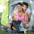 Young couple sat by tent — Stock Photo #14100955