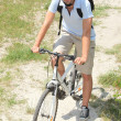 Man riding a bicycle — Stock Photo