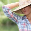 Stock Photo: Woman with Straw Hat