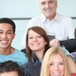 Teacher and pupils gathered together — Stock Photo