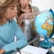 Boy and his babysitter studying — Stock Photo
