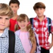 Schoolboy and his friends — Stock Photo