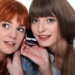Two women on mobile telephone — Stock Photo
