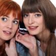 Two women on mobile telephone — Stock Photo #14101533