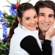 Couple in front of a Christmas tree — Stock Photo