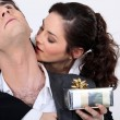 Womkissing her partner for present — Stock Photo #14102062