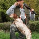 Hunter and his dog — Stock Photo