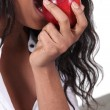 Afro woman eating apple — Stock Photo