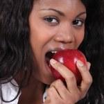 Woman biting apple — Stock Photo #14104447
