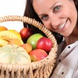 Woman holding fruit basket — Stock Photo #14104758
