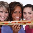Trio of girls eating giant sandwich — Stock Photo #14105308