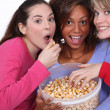 Friends eating caramel popcorn together — Stock Photo