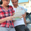 Stock Photo: Couple looking at map