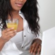Afro-American woman with glass of — Stock Photo #14107058