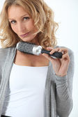 Hair-dresser holding brush — Stock Photo