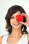 Young woman with red heart on her eye — Stock Photo