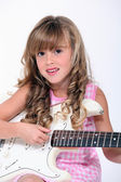 Fair-haired little girl playing bass — Stock Photo