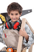 Young boy with adult carpenter — Stock Photo