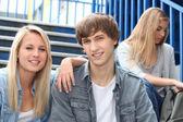 Three happy college students — Stock Photo