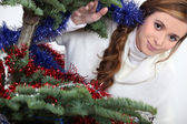 Young woman and a Christmas tree — Stock Photo