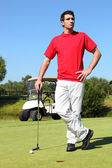 Golfer Standing next to the hole — Stockfoto