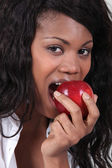 Woman biting apple — Stock Photo