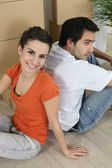Couple sat on floor — Stockfoto