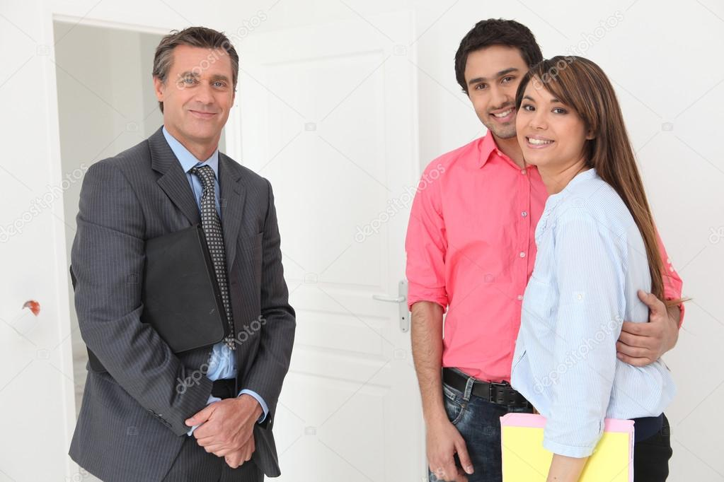 Young couple about to be shown around property — Stock Photo #14102360