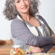 Portrait of mature womwearing apron — Stock Photo #14110615