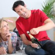 Couple celebrating new house — Stock Photo #14111156
