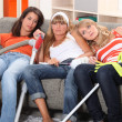 Girls relaxing after house-work — Stock Photo