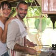 Stock Photo: Couple cooking on a barbecue