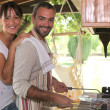 Royalty-Free Stock Photo: Couple cooking on a barbecue