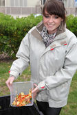 Woman making compost — Stock Photo