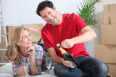 Couple celebrating new house — Stock Photo