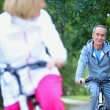 Middle-aged couple on a bike ride - Stockfoto