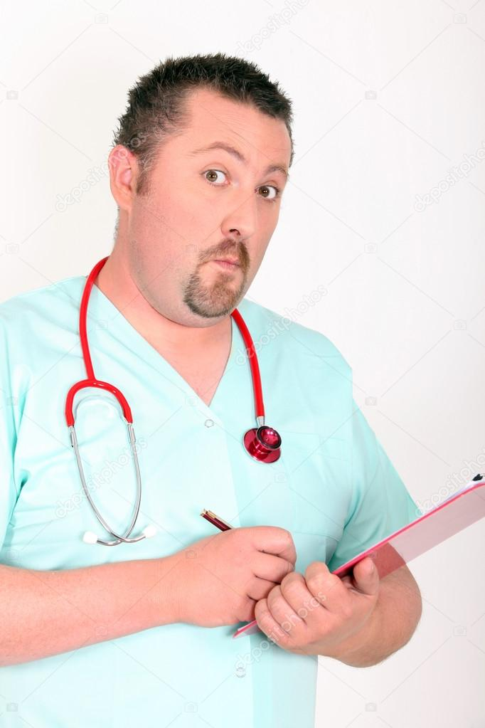 Doctor writing leaning on folders — Stock Photo #14129953