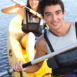 Teenagers kayaking — Stockfoto