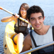 Couple in a canoe — Stock Photo #14130035