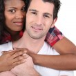 Afro woman and white man hugging — Stock Photo