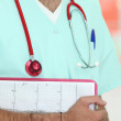 Stock Photo: Male nurse with medical record