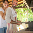 Couple having an outdoor barbecue — Stock Photo