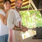 Couple having an outdoor barbecue — Stock Photo #14138513