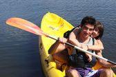 Young couple canoeing in lake — Stock Photo